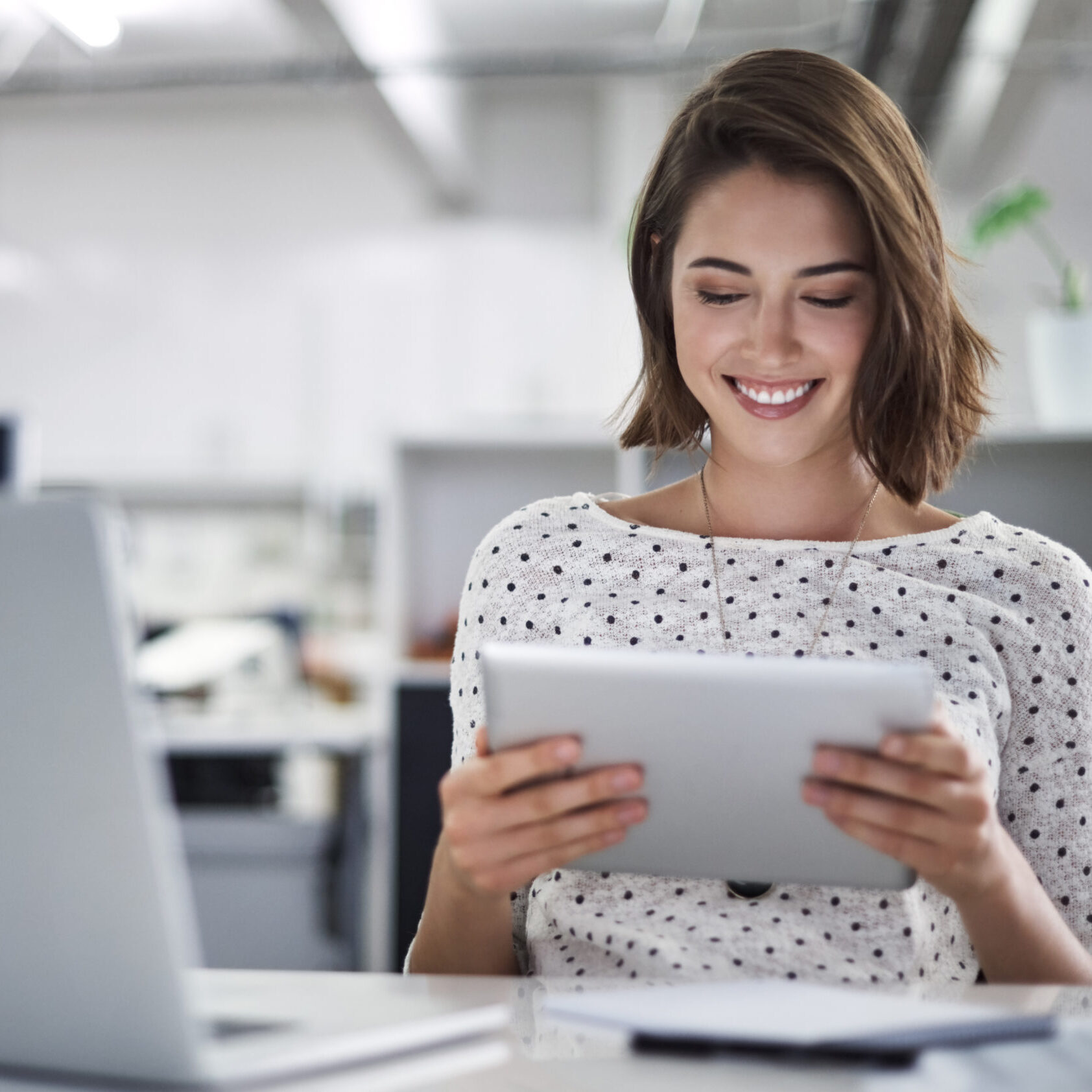 Shot of a businesswoman using her tablet at her desk